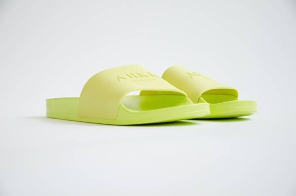 Bilde av Slides Yellow Glow W